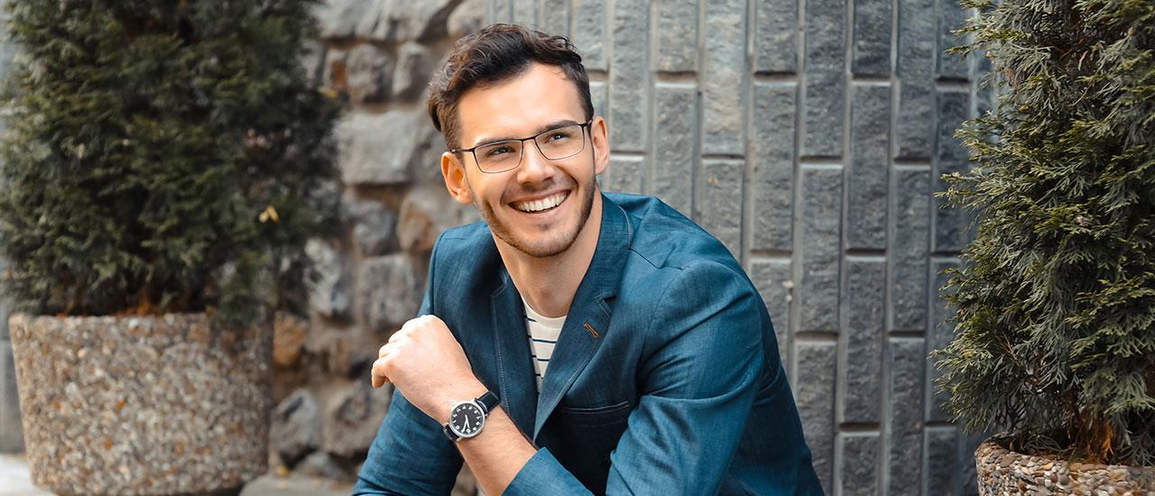 man wearing glasses sitting outside